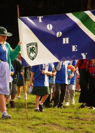 Toohey house team holding flag