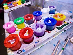 Pots of paint in tray